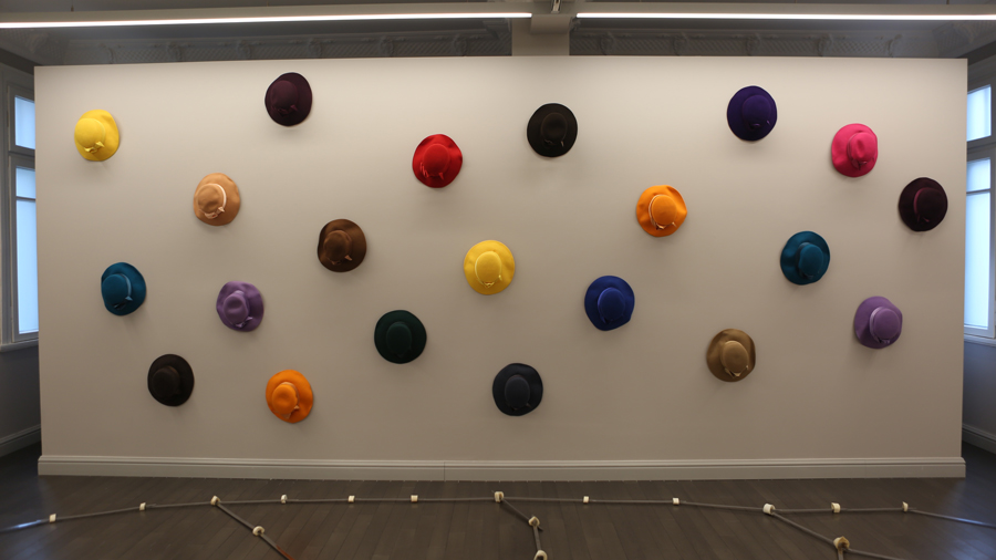 "Ayşe Erkmen, ""J, K & H"", 21 hats in various colours, 2010"
